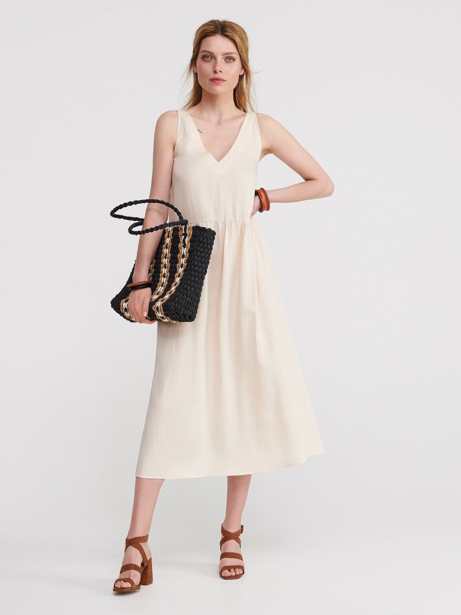 329b7dbab7 Gładka sukienka midi